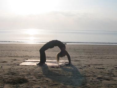 yoga pose on beach